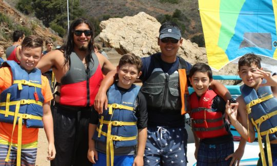 campers and counselors in life jackets at the waterfront