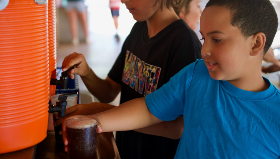 campers getting soda at the fountain