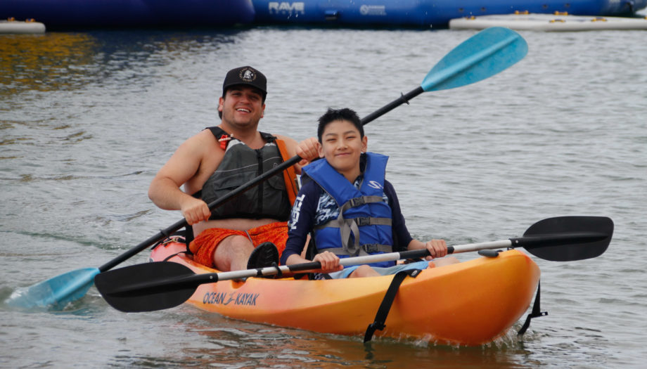 camper and counselor in a two person kayak